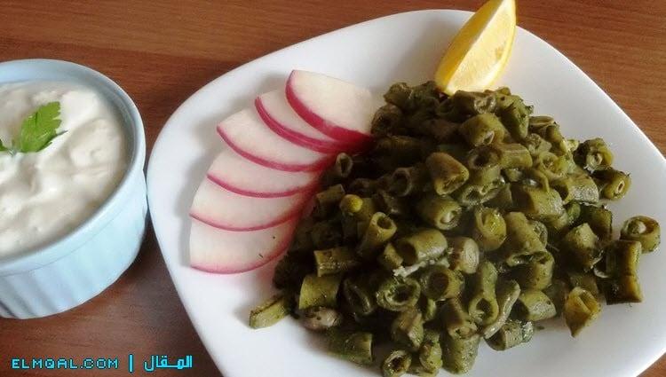 فول اخضر مقلي بالزيت بالكسبرة والثوم